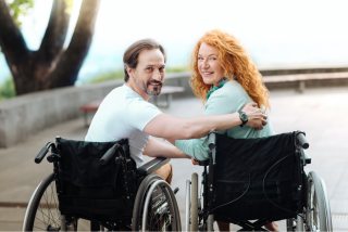 Couple-in-wheelchairs